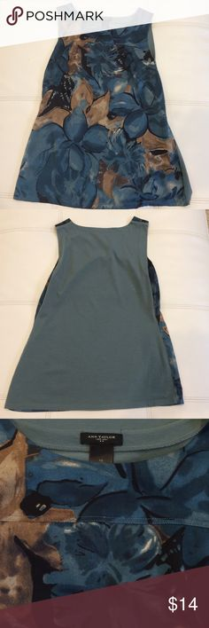 Like new and Taylor sleeveless blouse Like new Ann Taylor sleeveless blouse silky floral design in front soft cotton solid color  on the back Ann Taylor Tops