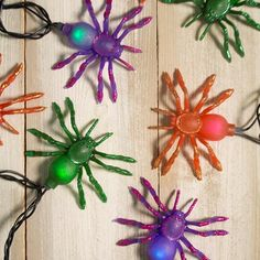Our multicolored Halloween spider LED string lights haunt guests as they fade from color to color during events and parties. This 10 foot black strand contains 10 LED orange, purple and green spiders.