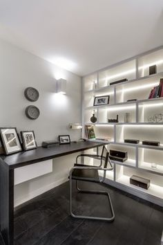 Home Office in Victorian conversion - white backlit shelves with wooden desk contemporary-home-office