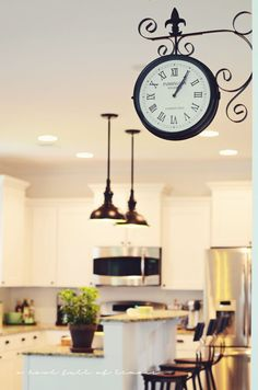 Station Double Sided Clock.  Would be great to hang over the laundry room door in the kitchen.