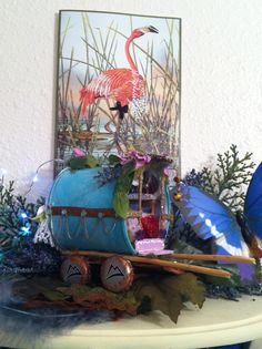 """..my cutesy li gypsy wagon,made out of an olive can,ECT..and """"gussied up"""" a flamingo print (with some glitter paint & black bow)"""