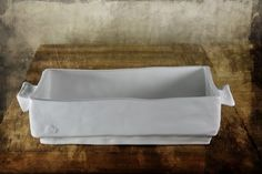 Casserole.  Oven, Microwave, Dishwasher safe.  Like our Facebook page for more details.  Ami