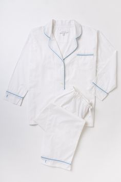 A great gift for your mother, your weekend hostess, or your best friend's birthday. 100% white cotton poplin pajamas with summer blue piping. $120 at Grace Hayes Linens!