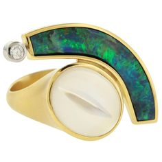 Boulder Opal Moonstone gold Ring by Tom Munsteiner | From a unique collection of vintage cocktail rings at https://www.1stdibs.com/jewelry/rings/cocktail-rings/