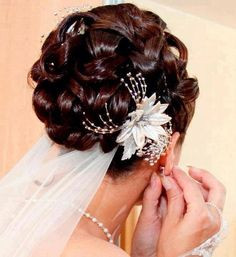 Wedding hair style...kinda different. Love the flower!