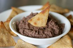 Easy Black Bean Dip with Whole Wheat Pita Chips 1 can black beans   2 T. liquid from can of beans   squeeze of fresh lemon or lime juice   1/4 t. onion powder   1/4 t. garlic powder   1/2 t. coriander   1/4 t. cumin   dash of cayenne pepper   big pinch of salt