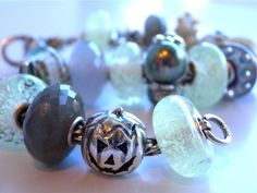 """The Ghost Bracelet, featuring limited Edition beads by Trollbeads... """"Inner Glow"""", """"Spider"""" and """"Pumpkin""""."""