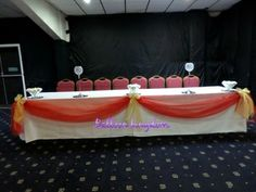 Organza top table swags and bows