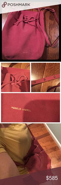 Mansur Gavriel pre loved bucket bag Purchased on the RealReal in December 2016. I can't do the bucket bag thing even though I want to love it. This bag measures approximately 12L x 12W x 6D. Cross body strap is adjustable. Pink suede has wear as seen in pics. Gold MG logo is readable, but also worn. Comes with purse, dust bag, authentication card from RealReal (though it's just a business card) and receipt from RealReal with my info & price blacked out. I give this a 6.5-7 out of 10…