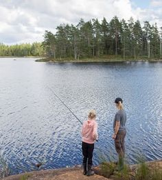 Mature woman and girl (12-13) fishing in Sweden lake