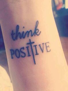 Think positive cross tattoo