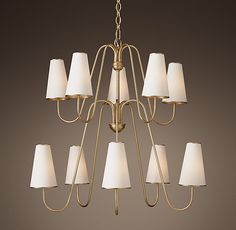 RH's Montreuil Chandelier:Slim, attenuated arms curve to hold tall, tapered shades in this chandelier by American designer Aerin. Influenced by both 1950s American and 19th-century French lighting, it delivers rich, ambient light with understated elegance.