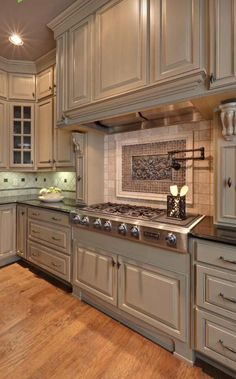 Tile backsplash variations.....nice combination and great focal point.....mixes well with the cabinetry!