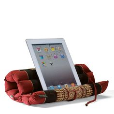 Our exclusive Thai Roll reading pillow is the most flexible and portable reading spot we've found. When creating these intricate designs, Thai weavers are inspired by the shapes of flower temples and benjarong (Thai ceramics). Ipad Holder, Book Holders, Tablet Holder, Tablet Stand, Phone Holder, Book Pillow, Reading Pillow, Sewing Crafts, Sewing Projects