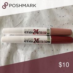 2 Maybelline lip gloss 2 Maybelline Lip Gloss, NWOT tags! Never used, haven't tried them. One of the color is red & the other color looks beige with pink. One side is the lip color gloss & the other side of the wand is a clear gloss. Make me an offer!! Priced to sell.! Lowest! Maybelline Makeup Lip Balm & Gloss