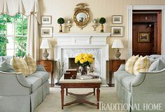 White and stately #fireplace mantel with marble surround is the perfect foil for family treasures in Atlanta. Designers Heather Dewberry and Will Huff.