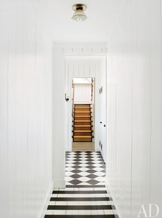 black and white tiled floor that stays black and white but changes tile style in the adjoining room