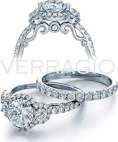 Verragio Three Stone Diamond Engagement Ring: This Verragio ring from the Insignia collection has two round brilliant cut side-stones that enhance the center stone of your choice, all surrounded by a diamond halo. The front and back of the ring has a scroll pattern and three diamond accents.