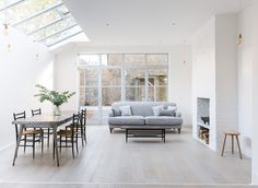 Lovely Victorian end of terrace house in Clapham Open plan living/dining area with fireplace and crittall windows . Crittal Doors, Crittall Windows, Decoracion Vintage Chic, Grey Wood Floors, Wood Flooring, Period Living, Open Plan Living, White Houses, White Walls