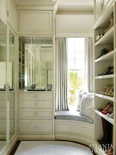 Walk-in closet w a window & seating
