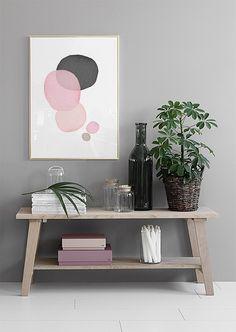 Abstraktia taidetta vaaleanpunaista, harmaata ja valkoista.