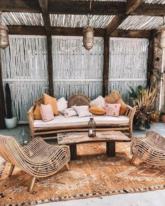 , A boho tropical patio with a wooden bench and lots of pillows catchy rattan chairs a wooden table and a boho rug plus Moroccan lanterns. , A boho tropical patio with a wooden bench and lots of pillows catchy rattan chai. Patio Tropical, Tropical Decor, Tropical Interior, Tropical Colors, Tropical Homes, Outdoor Sofa, Outdoor Spaces, Outdoor Living, Outdoor Furniture Sets