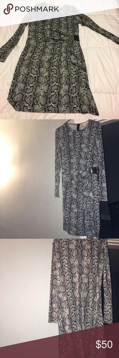 Michael Michael Kors Python print dress Sexy python print  jersey dress, round neck line, long sleeve. Perfect party dress. Only worn once MICHAEL Michael Kors Dresses Long Sleeve