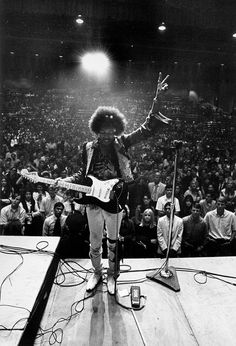 Jimi Hendrix, peace to the audience.