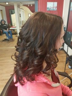 This was a huge length change took off at least 9 inches of damaged length. Put in some layers and styled with curl she hadn't been able to wear for a long time because her hair was too heavy.
