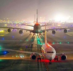 Air India Express Boeing 737-800 (foreground) and an Emirates Airbus A380-842 (background) taxiing at New Delhi
