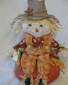 Scarecrow cloth doll sitting on a pumpkin by MorningMistDesigns
