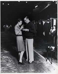 Dance marathon in Madison Square Garden Contestants have something to eat as the dancing goes on Photograph 1930's from UPI BPA