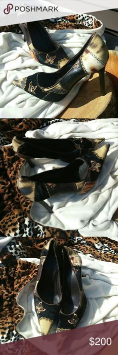 Roberto Cavalli high heels Hot to trot Roberto Cavalli high heels with animal print and butterflies. They are size 11 but run a bit smaller...more like size 10. Made in Italy Roberto Cavalli Shoes Heels