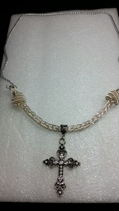 Silver viking knit necklace with silver cross pendant.