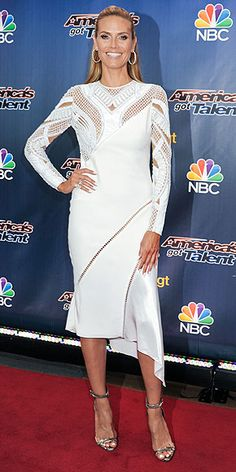 HEIDI KLUM America's Got Talent and Germany's got a model who's not afraid to go all-out in a white dress. Klum selects a mesh- and lace-embellished Versace midi with an asymmetrical hemline for the show's premiere in N.Y.C.