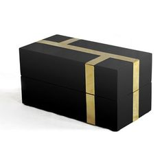 Black lacquer box with intersecting segments of brass inlay detail. #accessories #box #interiordesign