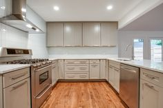 grey cupboards, wooden floors, white subway tiles, marble worktop