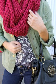 Sequins, chunky infinity scarf, and military blazer with Tory Burch bag.