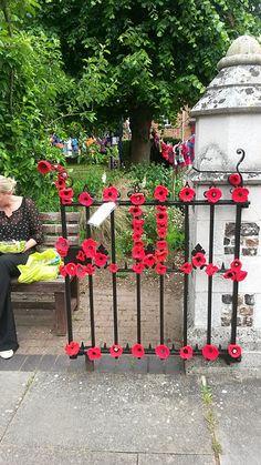 Ravelry: lilacliz1's Yarn bombing 2015 - Poppy - she used free  Remembrance Poppy crochet pattern by Katy Sparrow