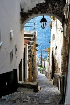 Alleyway leading to the sea in Praiano a town in southwest Italy. It is situated on the Amalfi Coast, between the towns of Amalfi and Positano. Oh The Places You'll Go, Places To Travel, Places To Visit, Amalfi Coast, Amalfi Italy, Positano, Dream Vacations, Vacation Spots, Capri Italia
