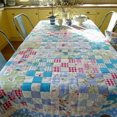 The thrifty quilt by Mia in Norway. Nine patch made from vintage sheets, old shirts and summer skirts.
