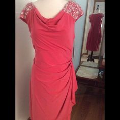 Designer Dress Beautiful, asymmetrical, scooped cowl-neck, coral dress with captain sleeves that are embellished with gorgeous silver sequins and clear gems. Zipper in back. Dresses Asymmetrical