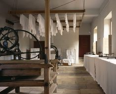 Airing racks, mangle, wooden clothes horses, flat irons and other early 19th century laundry equipment at Ormesby Hall, Yorkshire | National Trust Images