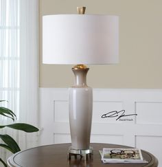 Uttermost Consuela Taupe Gray Glass Table Lamp. Light taupe gray glass with brushed nickel plated details and crystal accents. The round hardback shade is a warm taupe linen fabric with natural slubbing.