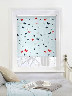 Butterflies Admiral Blackout Roller Blind - playful butterflies flutter by on this lovely roller blind that will bring a quirky personality into your room and provide you with excellent blackout protection
