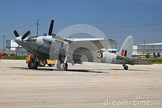 HAMILTON, ONTARIO/CANADA - JUNE 15, 2014: Only one in world flying De Havilland DH.98 Mosquito Designed in UK built in Canada refurbished in New Zealand combat aircraft known as The Wooden Wonder #stockphoto #editorial #aviation #aircraft #fly #stockphotography #Hamilton #Ontario #HamOnt #Mosquito #Bomber
