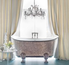 The claw footed bath is a surefire way to add some glamour to your bathroom, and can be covered in different colours of crystal.  Add some bling to your bathroom with this $300,000 Swarovski crystal encrusted tub from Catchpole & Rye.