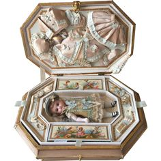 Very desirable antique 6 French all-bisque Mignonette in antique large fantastic original presentation box from the 19th Century! Inside the box is