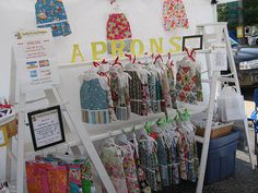 Love the idea of using ladders for display in a craft booth - Light-weight, portable and sturdy!