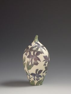 Cattleya orchid sgraffito vessel. Thrown ceramic vessel decorated with slips, carving and the technique of sgraffito